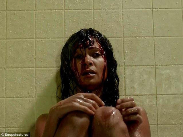 Traumatised: Thandie, who stars as undercover detective Grace, looked emotional as she sat with blood trickling down her face