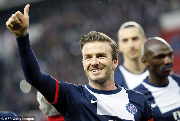Au revoir: Beckham gives the thumbs up to fans who chanted 'Stay David, Stay' during the match