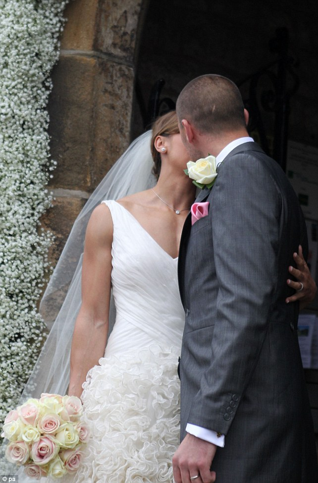 You may now kiss the bride! The happy couple gave each other a quick kiss for the waiting crowds