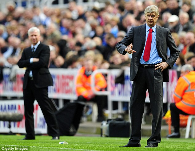 Background tension: There's no love lost between Arsenal boss Arsene Wenger and Newcastle's Alan Pardew