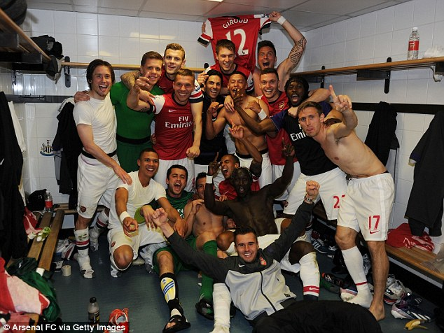 Party time: Arsenal pipped Tottenham to the Champions League place after beating Newcastle