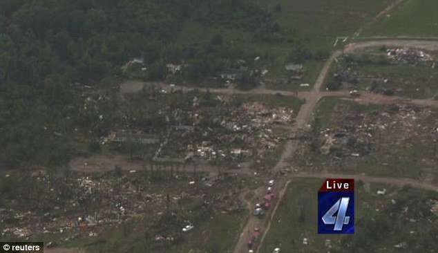 Wiped out: A residential area near Shawnee is pictured after a tornado tore through the area, destroying several homes
