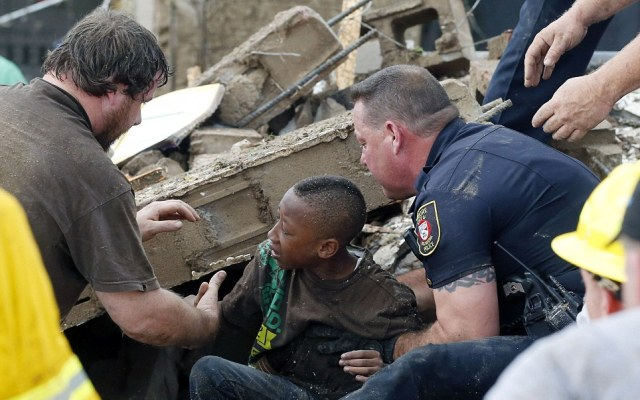A boy is pulled from beneath a collapsed wall at the Plaza Towers Elementary School
