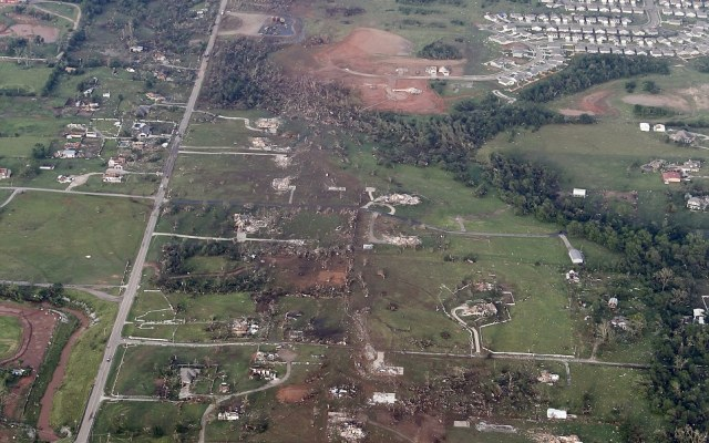 This aerial photo shows the remains of homes hit by a massive tornado in Moore, Oklahoma, on Monday
