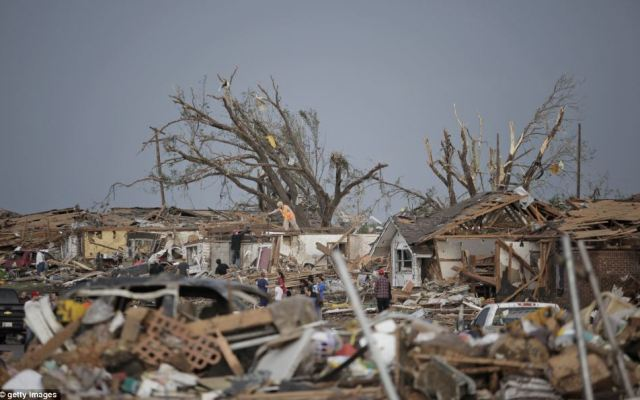 Scale: Bewildered residents assess the damage in their neighborhood