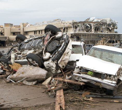Force: The upturned cars show the full force of the storm which ripped through the suburbs