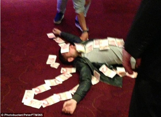 Professionalism? Bardsley was pictured covered in £50 notes