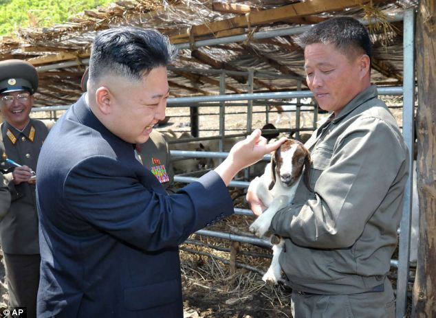 Even he's smiling: Leader Kim Jong Un pats a goat on the head