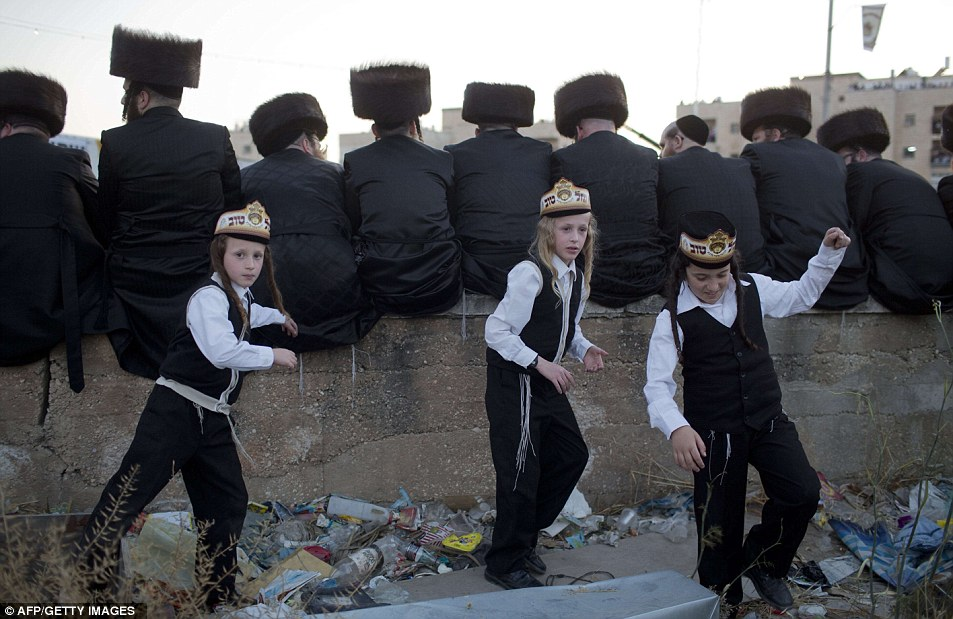 Ultra-Orthodox Jews of the Belz Hasidic Dynasty attend the wedding ceremony of Rabbi Shalom Rokach, the Grandson of the Belz Rabbi, in traditional dress