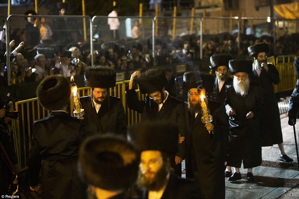 Ultra-Orthodox Jewish men lead Shalom Rokeach, grandson of the Chief Rabbi of Belz, Yissachar Dov Rokeach, during his wedding ceremony
