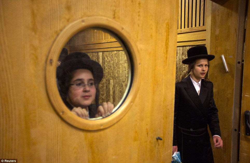 Ultra-Orthodox Jewish boys look at preparations for the wedding of the Chief Rabbi of Belz, Yissachar Dov Rokeach's grandson, in Jerusalem