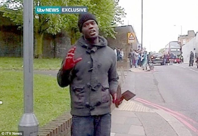 Terror: Holding two weapons in his hand, the man launches into his diatribe, just yards from where the body of the murdered off-duty soldier lay