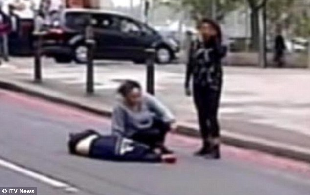 The Angel of Woolwich: Amanda sits next to the dead soldier after the brutal killing while her daughter Gemini looks on