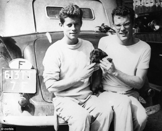 """ca. 1932 --- John F. Kennedy, """"Dunker"""" the dog, and Lem Billings at the Hague, during their Europe trip. --- Image by   CORBIS"""