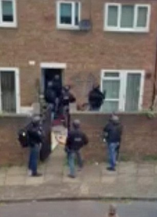 Raid: police moving in on Rikki Thomas's Greenwich house last week