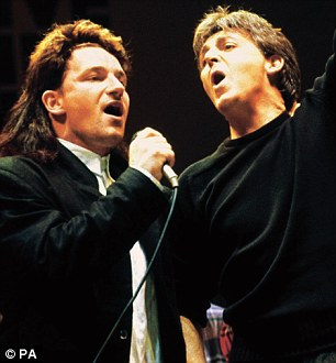 Bono and Paul McCartney during the finale of the Live Aid Concert at Wembley Stadium