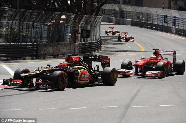 Lost ground on Vettel: Kimi Raikkonen (left) finished 10th and Fernando Alonso (right) seventh