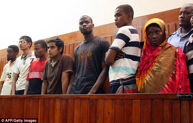 Adebolajo (centre in black top) was sent back to Britain after claiming he had been tortured in Kenya