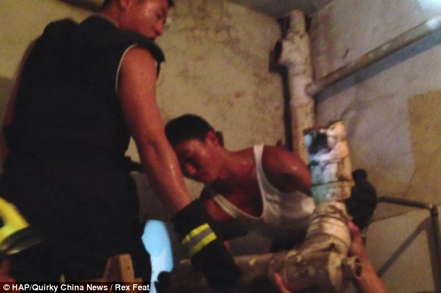 Firefighters gently carried away the section of pipe that contained the terrified baby