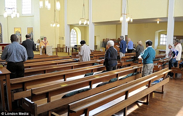 Empty pews: 18th-century parishioners crowded into St George-in-the-East hear John Wesley. Only 12 people attended the service