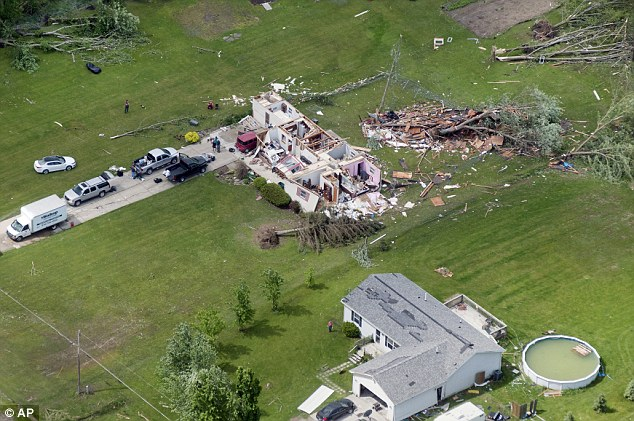 Devastated: This home was completely destroyed when four tornadoes touches down in Fenton Township, Michigan, near Flint, on Tuesday