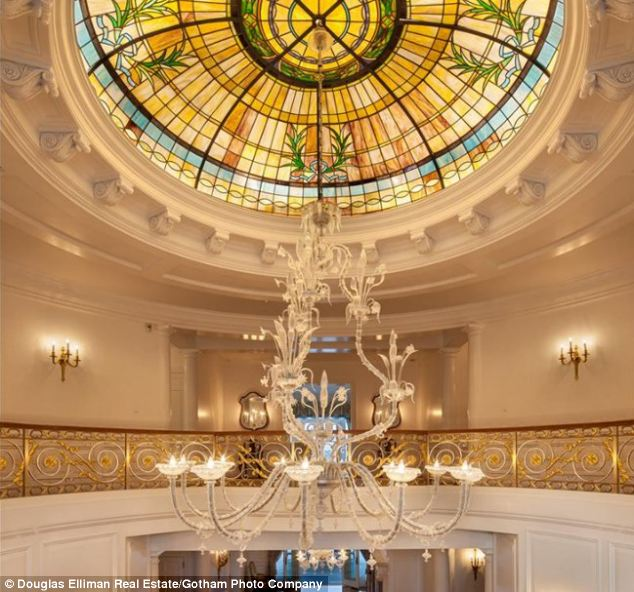 Grand: The entrance has a cast-bronze double staircase and a 19th-century stained-glass skylight