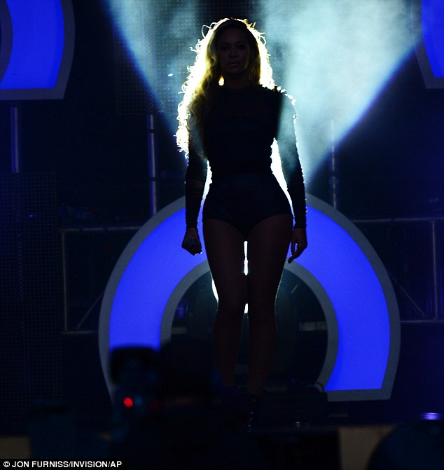 Making her entrance: The crowd went wild for Beyonce as she headlined the concert at Twickenham Stadium