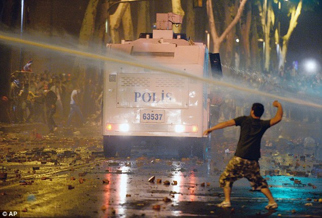 Dangerous: The streets of Istanbul can be seen littered with rocks and debris on Saturday night
