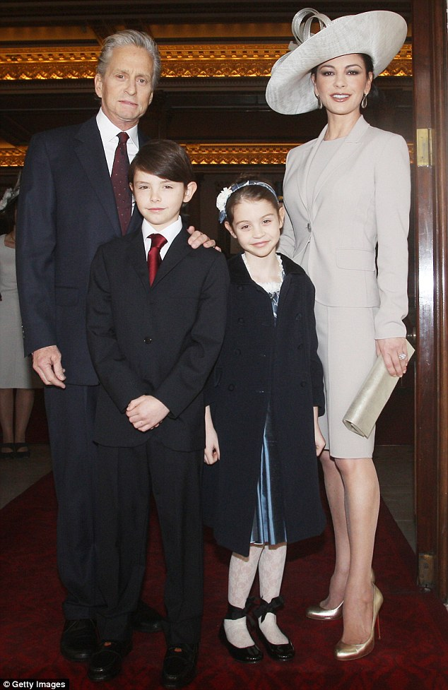 Family man: Michael with his wife Catherine Zeta-Jones and their two children Dylan and Carys