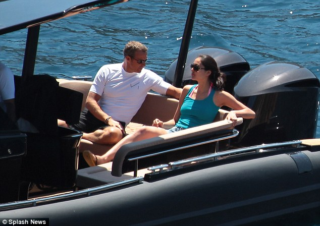 Luxury: Vladimir Doronin and Luo Zilin are on holiday together in Ibiza. The couple are seen here on a speed boat.