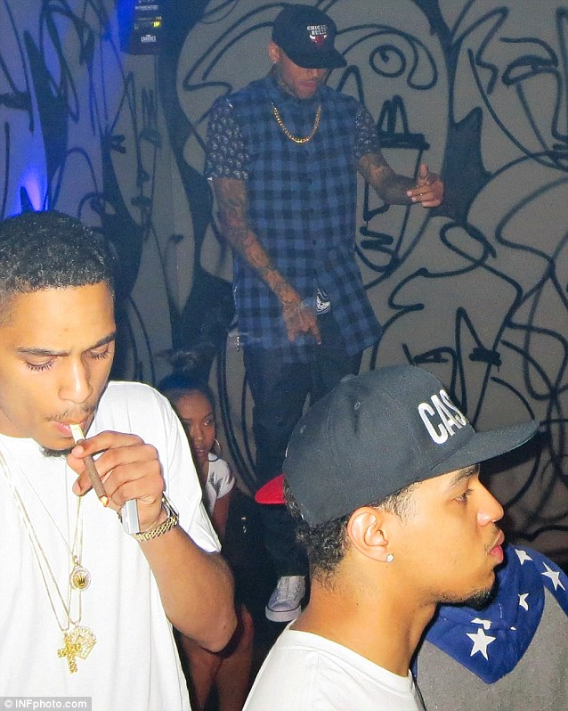 By his side: Karrueche kept a watchful eye inside EVR nightclub in New York City while dancing to Rihanna, Jay-Z and his own songs