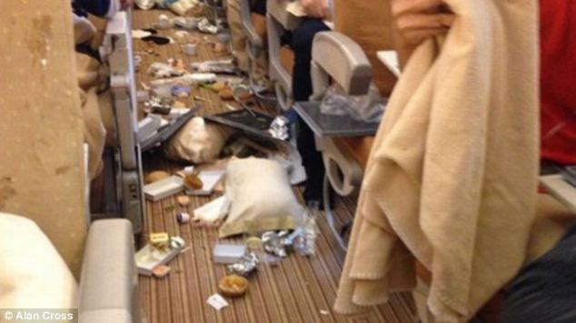 Meals ended up in aisles and coffee on the ceiling after plane lost altitude. Picture Daily Mail / Alan Cross