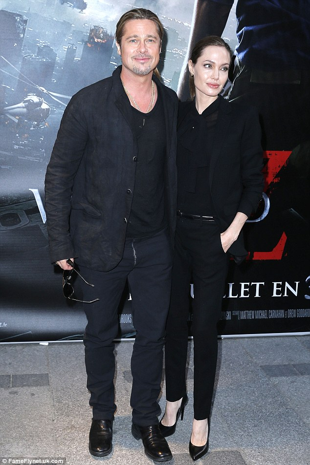 By his side: Angelina has been happy to support her fiance during his promotional activities