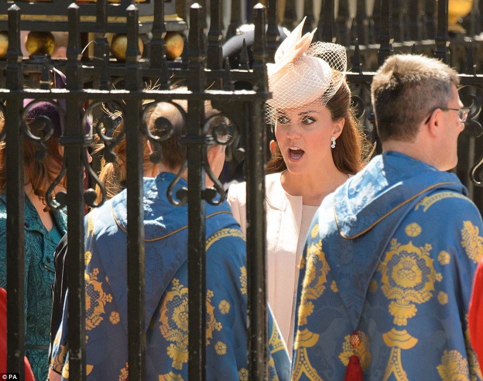 Look of shock: The Duchess of Cambridge leaves Westminster Abbey today after the service