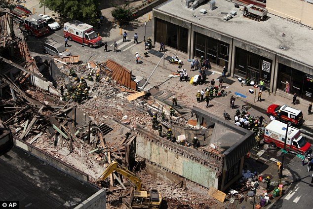 Mess: Rescue personnel work the scene of a building collapse in downtown Philadelphia, Wednesday, June 5, 2013