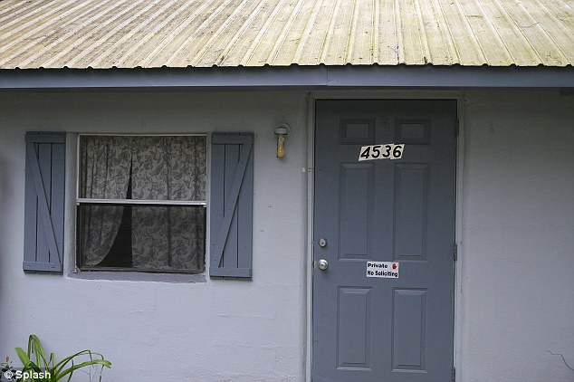 Home sweet home: Mrs Mackenzie's home front door has a sign that reads 'Private. No soliciting.'