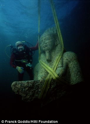 A colossal statue of red granite representing the god Hapi, which decorated the temple of Heracleion