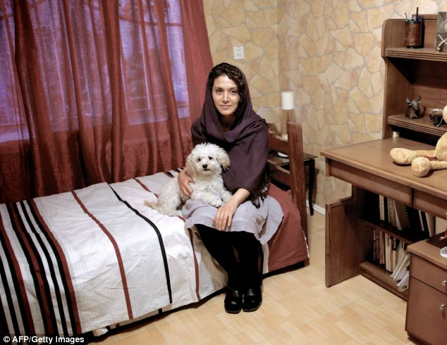 Dogs will be confined to houses even more under the clampdown. Pictured engineer Azar and her dog Pony