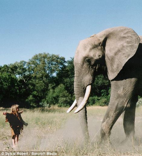 Tippi, aged 6 dancing with Abu the 34-year-old elephant in Okavango Swamps, Botswana