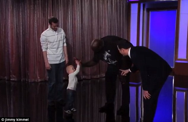 Best of luck: A friendly hi-five as Shaq bends his 7ft 1in frame to greet Titus ahead of the challenge