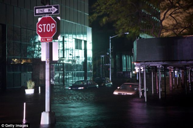 Danger: A flooded street is seen on October 29, 2012, in the Financial District of New York