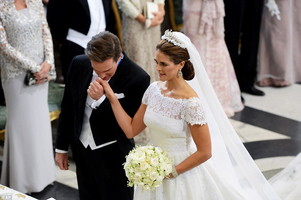 Fairytale ceremony: American financier Christopher O'Neill kisses the hand of his bride Princess Madeleine of Sweden in Stockholm's Royal Chapel today