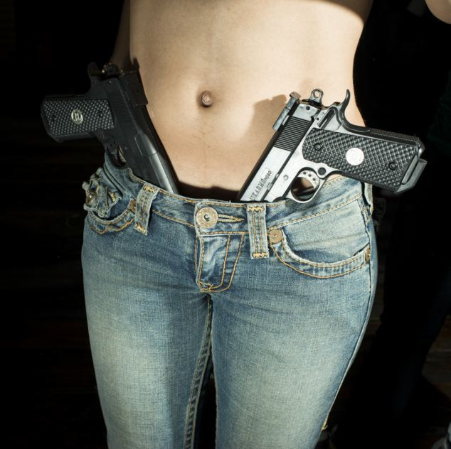 Dangerous curves: Some outfits were accessorized with guns om set