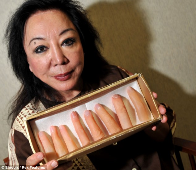 Examples: Plastic surgeon Maria Niino, holds prosthetic fingers that she makes for yakuza members