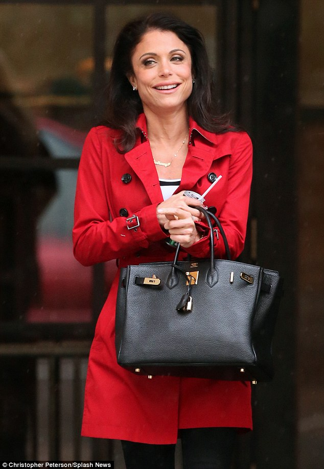 Bethenny Frankel Shelters From The Rain Under Umbrella