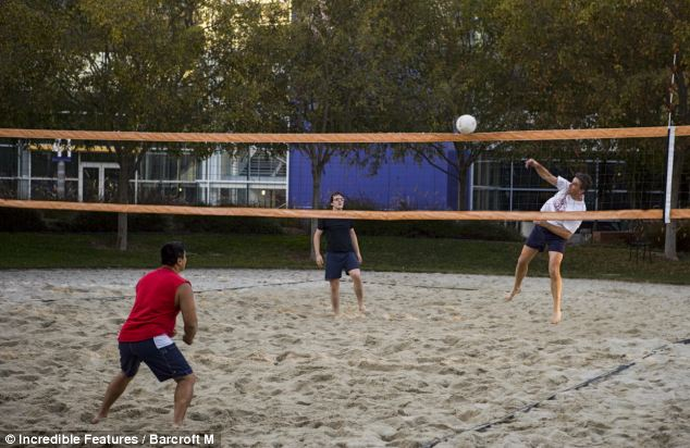 Googlers enjoy a game of volleyball right on campus