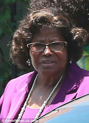 Battle: Michael's mother Katherine Jackson (left) is pursuing a lawsuit against AEG. CEO Randy Phillips told jurors this week he was 'scared to death' of one of the singer's doctors