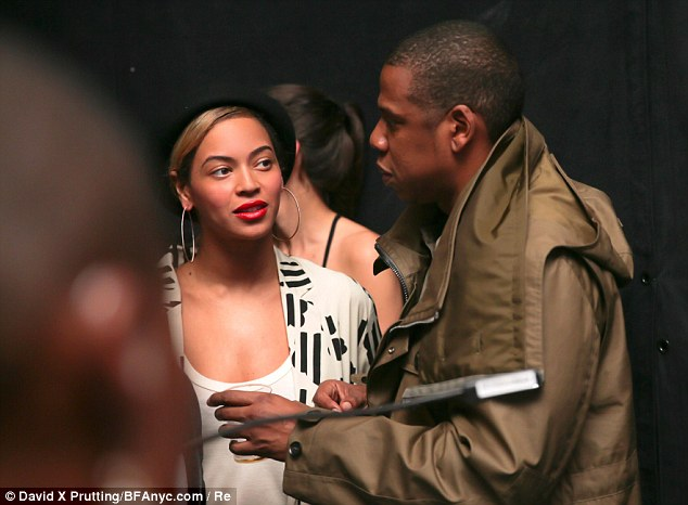 Party people: Famous friends Jay-Z and Beyonce Knowles attended the birthday dinner - which Kim was unable to fly to