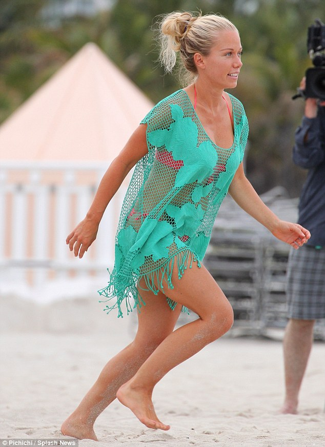 Former Playboy Model Kendra Wilkinson Drapes Bikini Body In Fishnet Cover Up As She Celebrates
