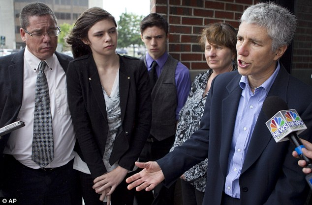 Attorney's statement: Jennifer Levi, attorney for transgender student Nicole Maines, second from left, speaks to reporters outside the Penobscot Judicial Center